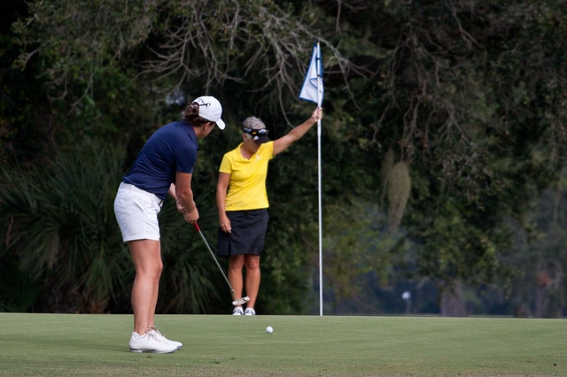 Women Golfing Outside