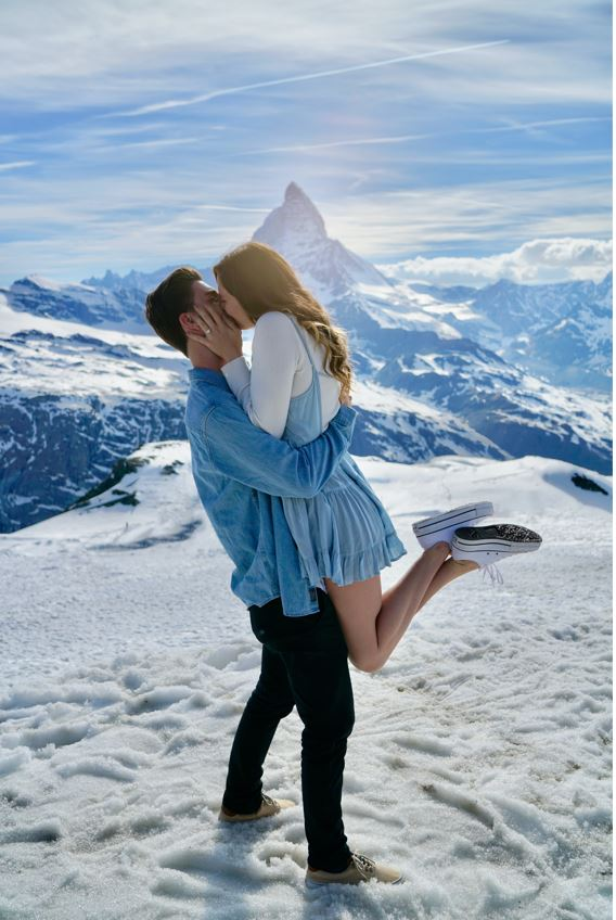 couple engaged in snow